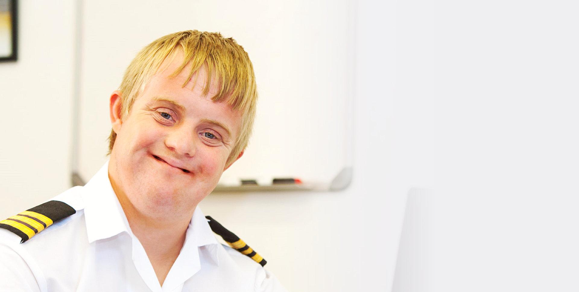 happy child wearing a seafarer's uniform