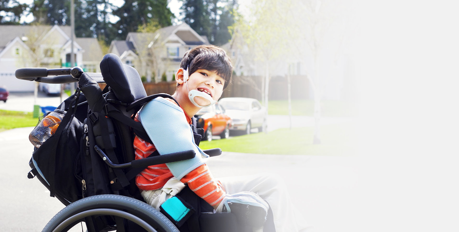 smiling kid on wheelchair