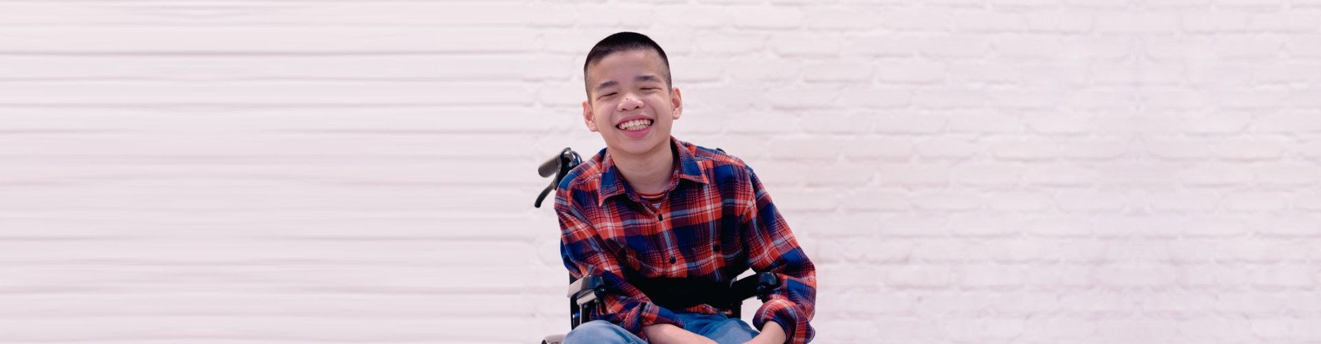 happy boy on a wheelchair